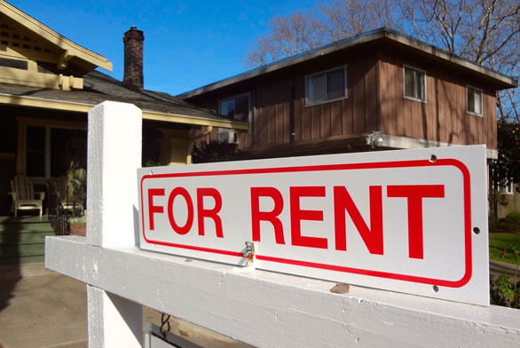 """""""for rent"""" sign in front of rental house"""