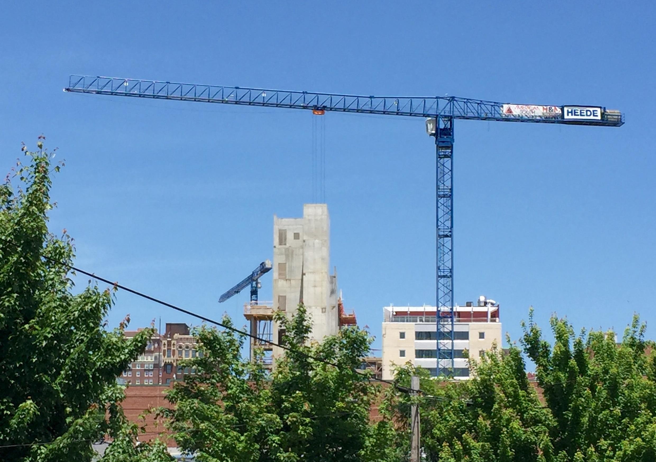 Photo of construction cranes