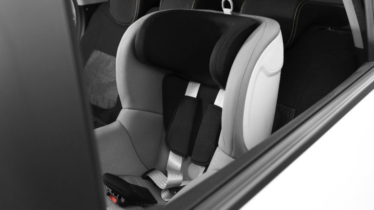 empty car seat installed in a car