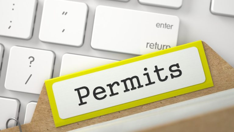 permits folder resting on computer keyboard
