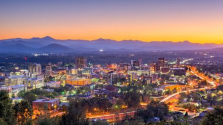asheville city with purple sunset