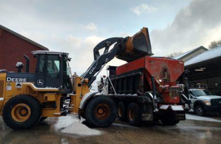 Loading salt spreader truck