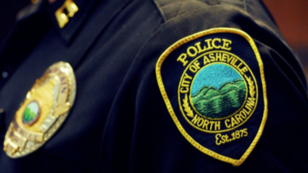 city of asheville police badge on shirt