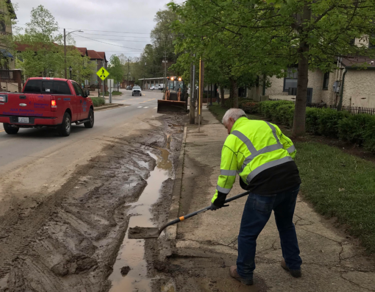 post flood road cleaning continues in Biltmore Village