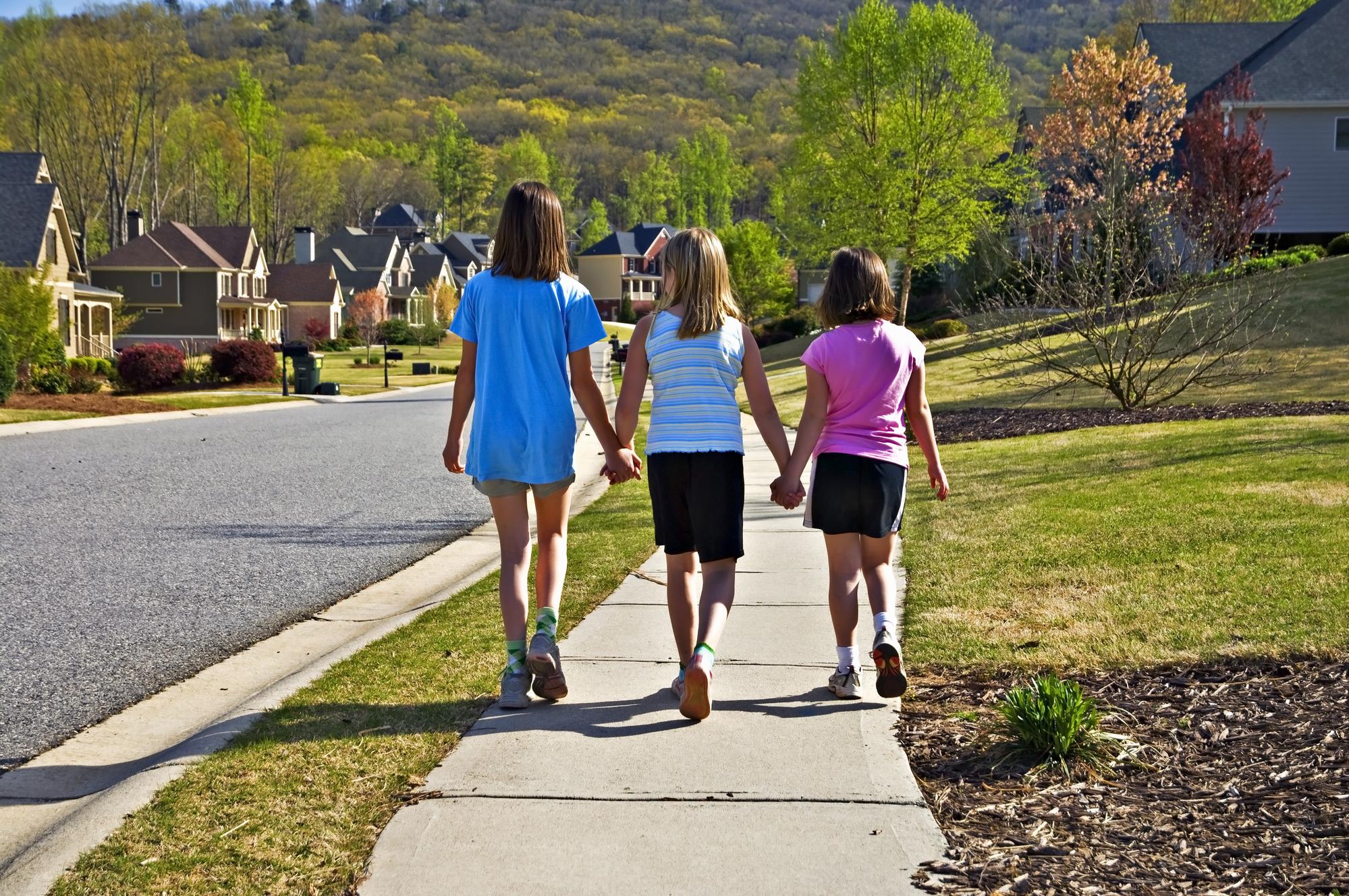 Children walking on a sidewalk