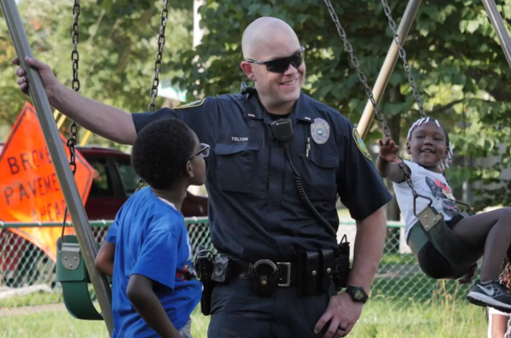 Officer with children from National Night Out 2018