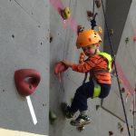 Lil boy on rock wall
