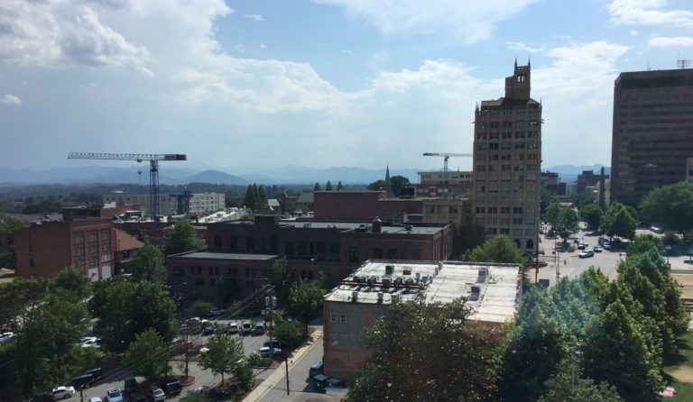 Two cranes for construction building in downtown asheville