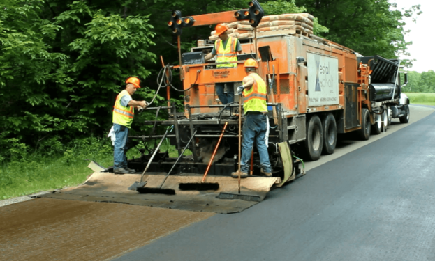 microsurfacing truck laying product on road
