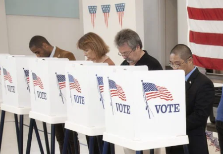 Photo of 4 people voting