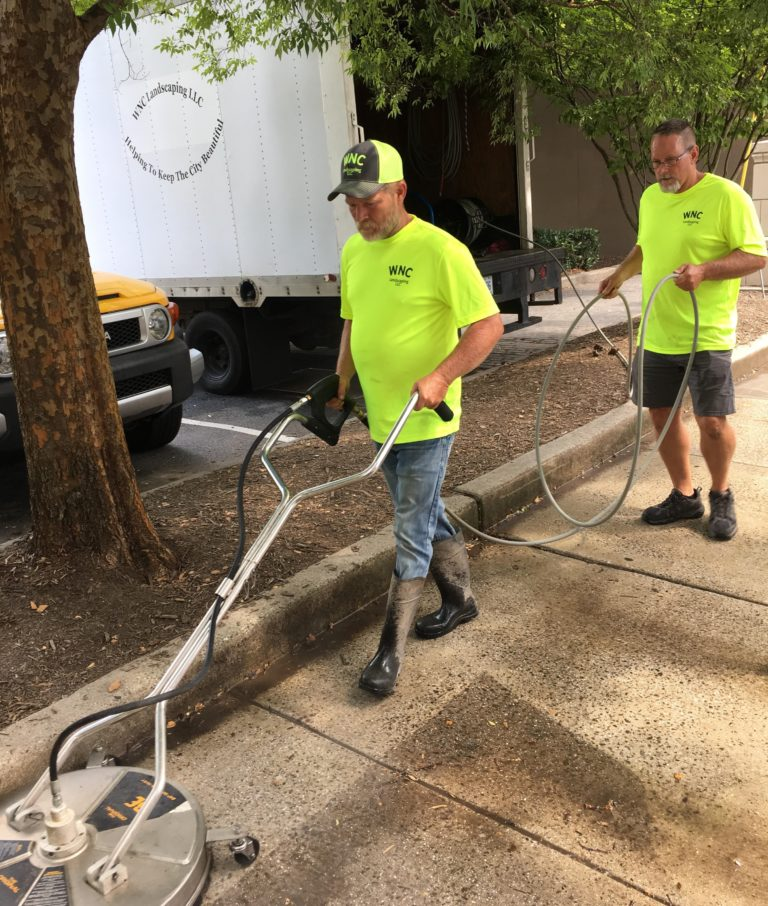 Workers cleaning downtown sidewalk