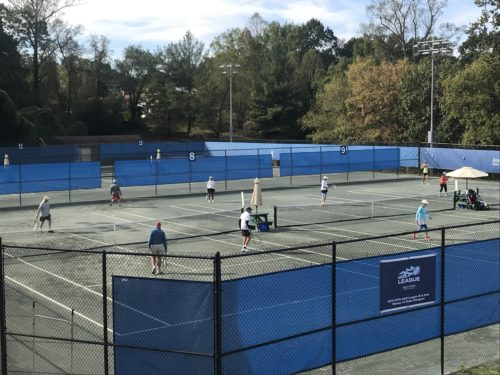 people playing on the courts at aston park tennis center