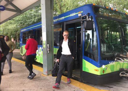 ART bus rider walking off bus