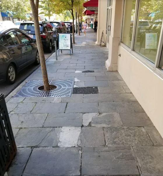 Picture of broken Haywood Street sidewalk