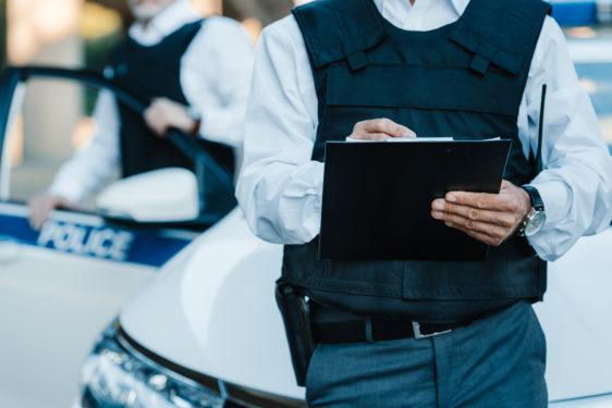 photo illustration of officers wearing bulletproof vests