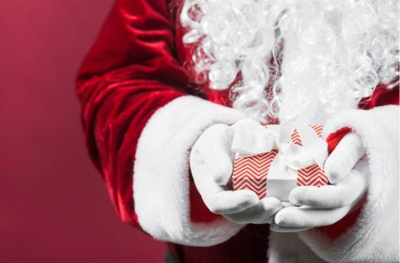 Santa hands with present