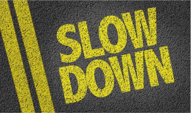Words slow down printed on road