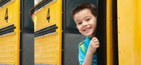 Teacher Resource linked to image of child on a school bus smiling