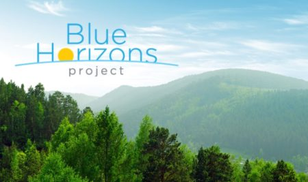 Blue Horizons Project logo with mountains photo