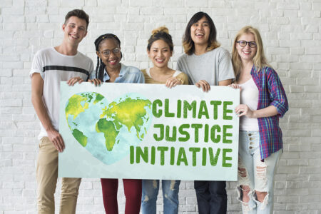 people holding sign that says 'climate justice initiative'